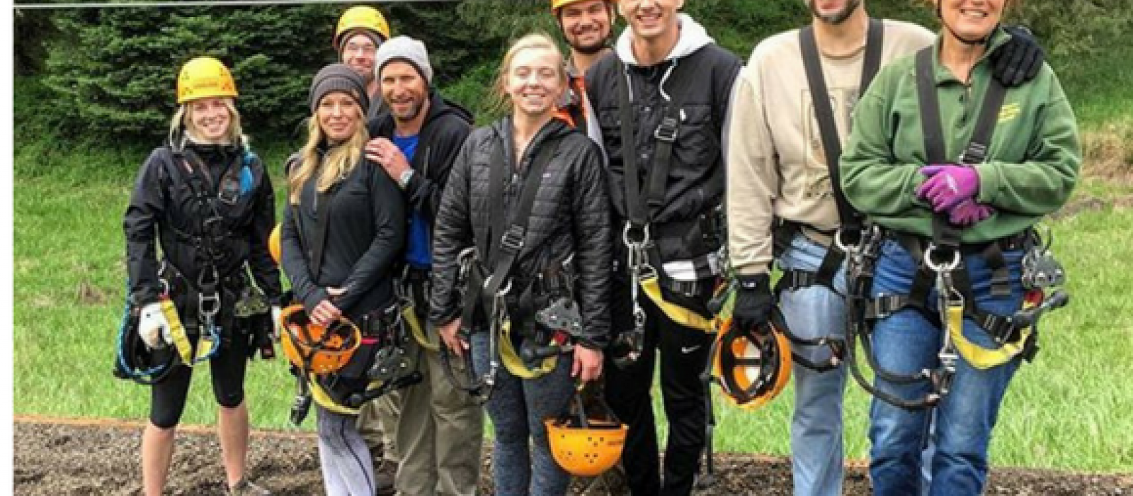 multi-generational group of tree climbers at Tree to Tree Adventure Park