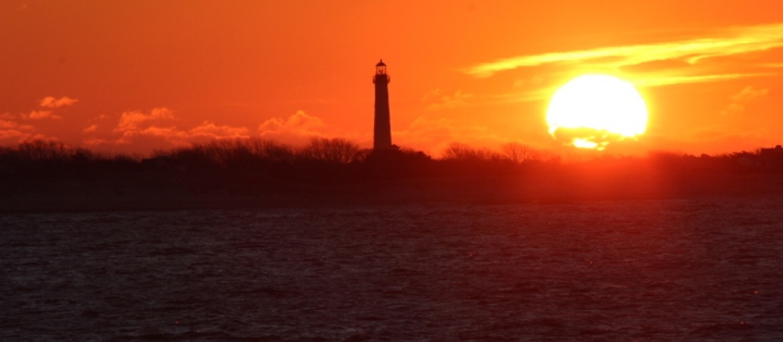 Sunrise by the Cape May Lighthouse as seen on the Cape May-Lewes Ferry