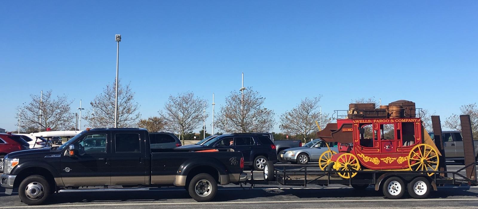 Wells Fargo parade vehicle being towed on to the Cape May-Lewes Ferry