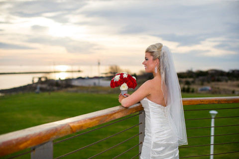 Bride looking over the balcony from the Sunset Lounge at the Cape May Lewes Ferry