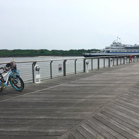 a bike on the dock as the ferry pulls in
