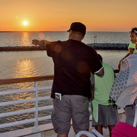 A family enjoys the view aboard the Cape May-Lewes Ferry