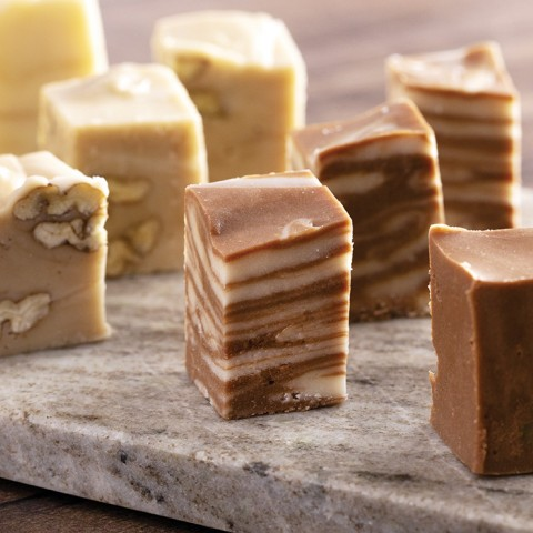 fudge samples lined up on a tasting board