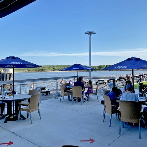 socially distanced seating with a waterfront view at On the Rocks in Cape May, NJ