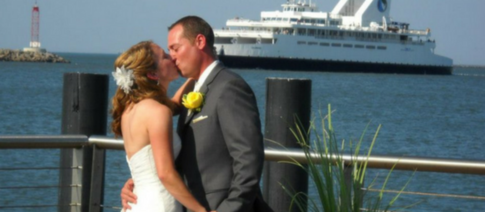 wedding kiss while the Ferry comes in at the Cape May-Lewes Ferry